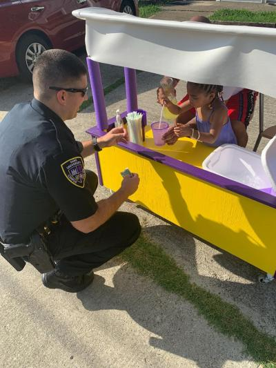Ava Lewis, a three-year-old girl, is selling lemonade to help